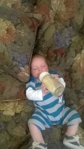 Holding his own bottle
